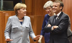 German Chancellor Angela Merkel, speaks with Theresa May, French President Emmanuel Macron prior to a round table meeting in Brussels.
