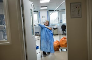 A cleaner prepares to clear and disinfect a bay