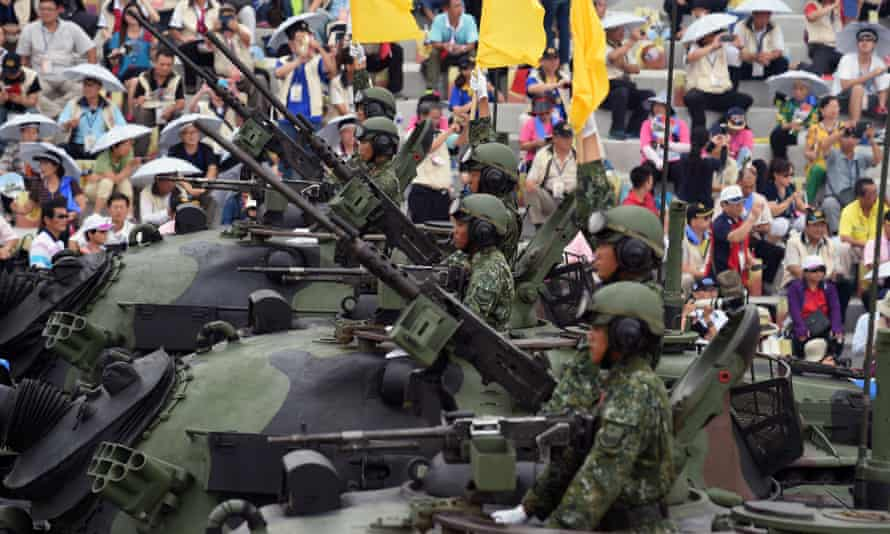 Soldiers salute from the M60A3 tanks during a parade commemorating the 70th anniversary of the second world war