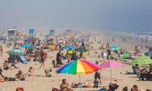People enjoy the beach amid the novel coronavirus pandemic in Huntington Beach, California on 25 April 2020.