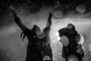 Two men are sprayed with high-pressure water by police officers during a demonstration near the Oceti Sakowin camp in November 2016