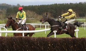 Paul Townend, right, collides with the rail and takes Finian's Oscar out of the race after he had inexplicably steered Al Boum Photo around the last fence.