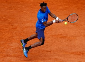 Gael Monfils gets airborne as he bashes a backhand to Adrian Mannarino.