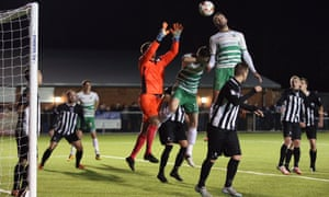 Connell Rawlinson and Steve Saunders of The New Saints challenge for a high ball against Cefn Druids