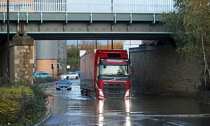 A lorry drives through flood water near Meadowhall shopping centre in Sheffield
