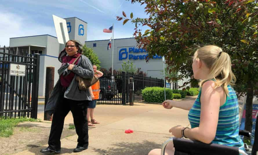 An anti-abortion campaigner addresses a passerby outside the Planned Parenthood clinic in St Louis. The clinic, the last in the state offering abortions, could close this week.