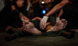 Paramedics attend the scene of an extrajudicial killing in Manila in September