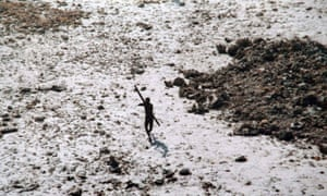 A tribesman aims his bow and arrow at an Indian coastguard helicopter over North Sentinel island.