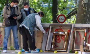 Police pack up the frames of the stolen paintings outside the Paris Museum of Modern Art following the theft of five paintings in 2010.