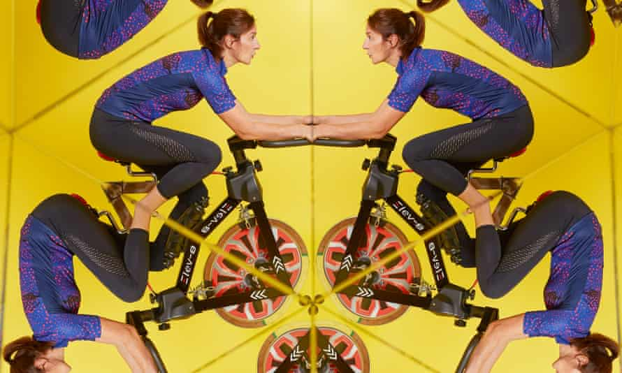 Photograph of Zoe Williams on exercise bike reflected