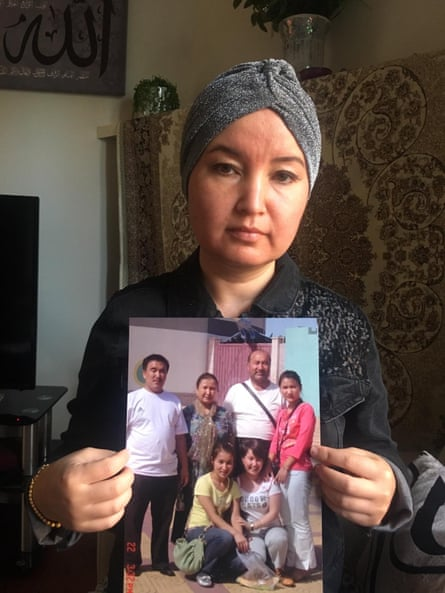 Fatimah Abdulghafur, a Uighur woman based in Sydney, Australia. Shows a picture of family members who have disappeared in Xinjiang. July 2019
