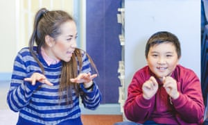 STC teaching artist Courtney Steward with a student at Ford Street primary school for Sydney Theatre Company's School Drama program