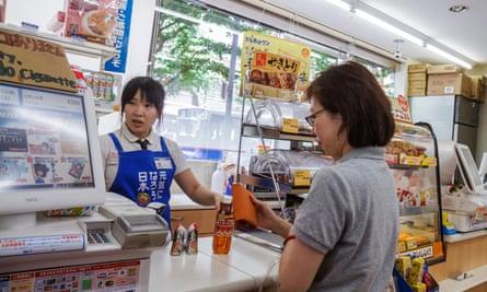 convenience store worker Tokyo Japan