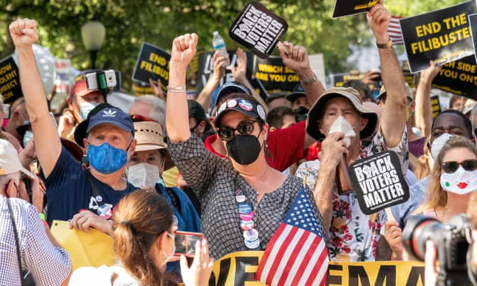 People participate in a rally to support voting rights at the Texas sate capitol in Austin.