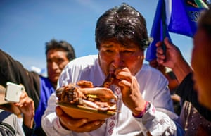 Morales eats a dish prepared by a supporter on the road between Uyuni and Oruro