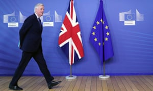 Michel Barnier walks at the European commission headquarters in Brussels