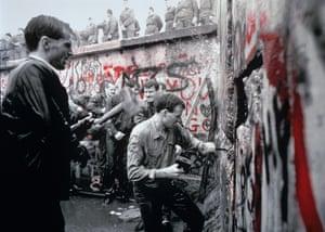West Germans demolish the Berlin Wall in 1989.