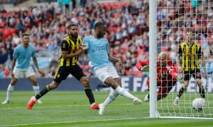 Raheem Sterling scores Manchester City's sixth goal against Watford.