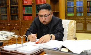 A picture from North Korea's official Korean Central News Agency taken on 3 July 2017 shows Kim Jong-un signing the order to carry out the country's latest missile test.