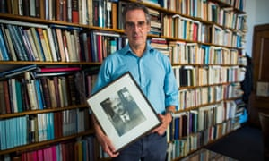 Mark Mazower with a photograph of his grandfather, Max, in his Columbia University office.