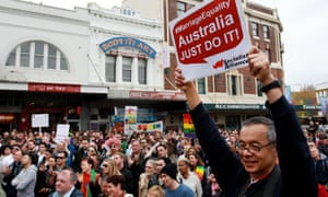 Protesters call on the Abbott government to allow a free vote on marriage equality.