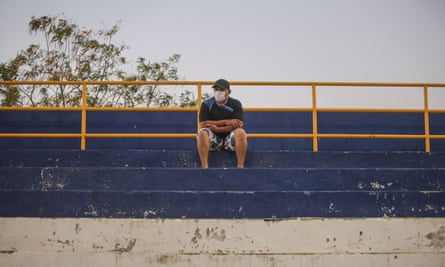 A fan with a face mask watches Managua take on Diriangén.