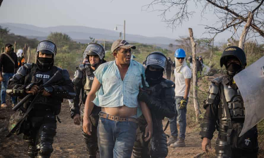 Jhan Carlos Frías is arrested trying to protect his community of Roche from eviction in the Cerrejón mining zone in La Guajira, Colombia.