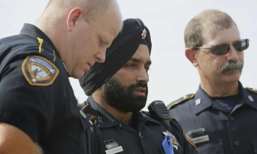Sandeep Singh Dhaliwal, center, a Harris county sheriff's deputy, was known as a trailblazer for being one of the first to wear a turban and beard as part of his uniform.