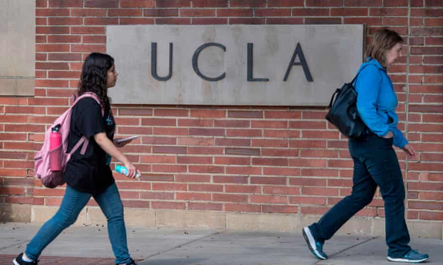 People walk through UCLA campus in Westwood, California on 6 March 2020.