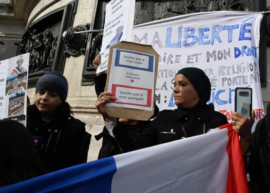 Muslim women protest in Paris in October 2019 for the right to continue wearing headscarves.