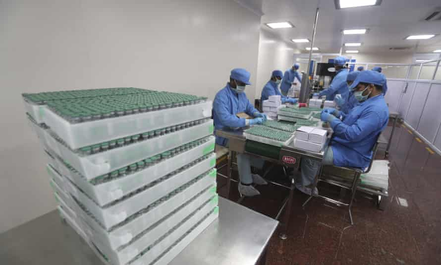 Employees pack boxes containing vials of AstraZeneca's Covid vaccine at the Serum Institute of India, in Pune, India.