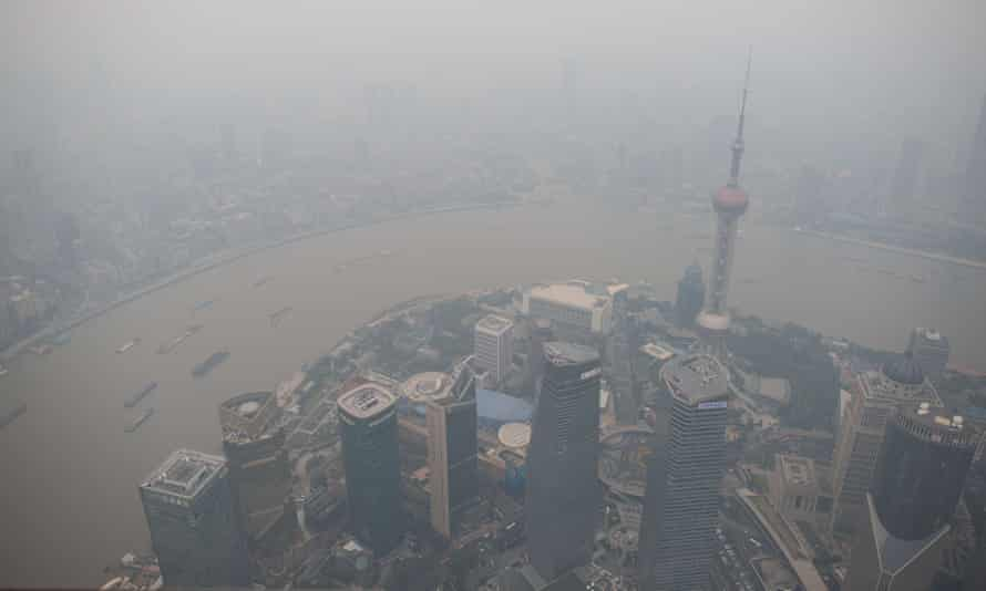A general view shows the skyline of the Lujiazui Financial District in Pudong, seen from the 109th floor of the Shanghai Tower (still under construction), covered in smog in Shanghai on October 16, 2014.