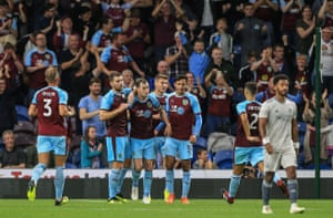 Ashley Barnes, number 10, is congratulated by his teammates after notching from the penalty spot for Burnley's third goal.