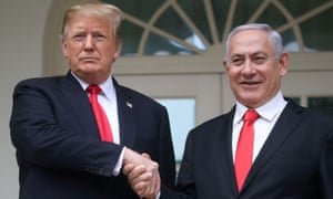 Donald Trump shakes hands with Benjamin Netanyahu at the White House in Washington DC on 25 March.