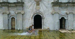 Winner of the Mobile Phone category: Lloyd Ericson Castro Rodriguez for 'After The Monsoon' Rodriguez's image shows the disruption caused by the monsoon rains. The young boy pictured is playing on his bicycle in a flood in front of the San Guillermo Parish Church in Bacolor, Pampanga.