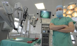 A doctor with a surgical robot at a hospital in Jena, Germany