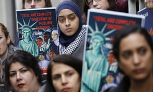 Demonstrators rally outside in Richmond, Virginia, on Wednesday where the US court of appeals will hear arguments against Donald Trump's existing travel ban.