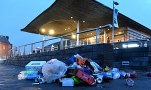 Litter and rubbish left by revellers outside the Senedd, the Welsh Parliament building in Cardiff Bay, South Wales, after a day of good weather.