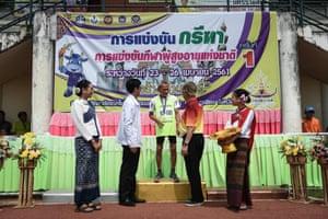 Sawang Janpram, 98, receiving a medal