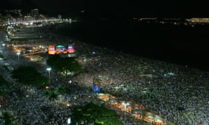 Crowds celebrate the new year at Copacabana Beach, Rio, Brazil