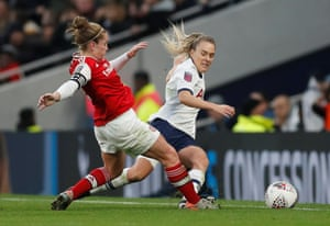 Tottenham Hotspur's Josephine Green, tackled by Arsenal's Kim Little.