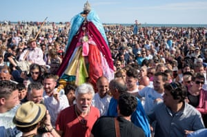 Gypsies carry the sculpture of 'Sara the Black' to the sea after a church service and a procession in Staintes Maries de la Mere near Arles, France.