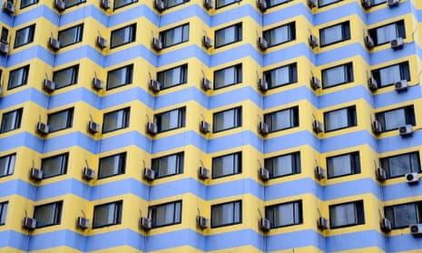 Air conditioning units hang off the back side of a row of buildings in Shenyang, China.