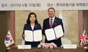 South Korea's trade minister Yoo Myung-hee with UK international trade secretary Liam Fox.