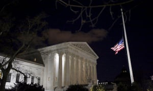 The US flag is seen at half mast at the supreme court