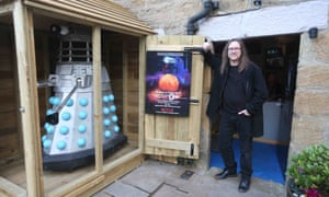 Neil Cole stands beside the Dalek shed outside his home in Allendale, Northumberland