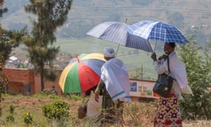 Women in the Rulindo district walk in the midday sun to an eye screening centre