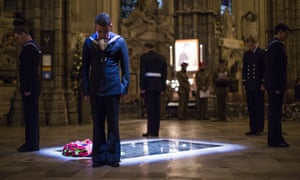 Military personnel (above and below) stand at the tomb of the Unknown Warrior during a vigil at Westminster Abbey.