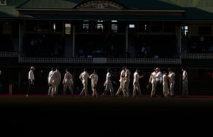 A line of men in cricket whites