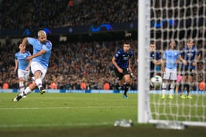 Sergio Aguero scores his second from the spot.